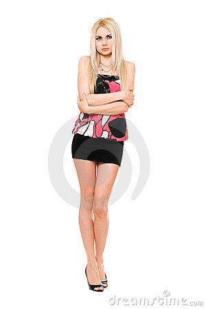 Beautiful leggy young blonde in black miniskirt
