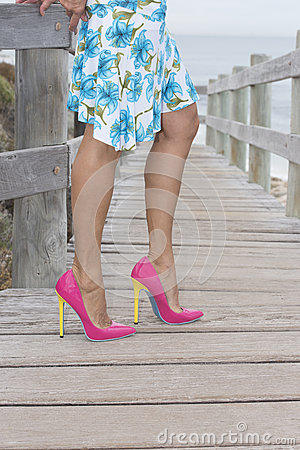 Beautiful legs in high heel shoes outdoor.
