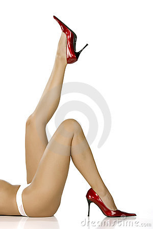 Beautiful legs in red shoes