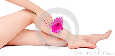 Beautiful legs of young woman and flower