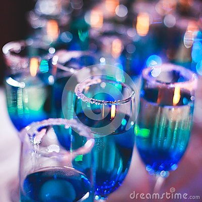 Free Beautiful Line Of Different Colored Alcohol Cocktails With Smoke On A Christmas Party, Tequila, Martini, Vodka, And Others On Part Royalty Free Stock Photo - 105730345