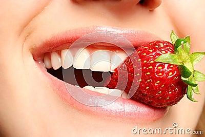Beautiful lips holding a straw