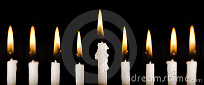 Beautiful lit hanukkah candles on black.