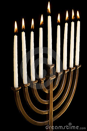 Beautiful lit hanukkah menorah on black background