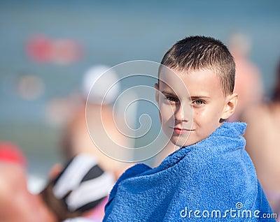 Beautiful little boy wrapped in a towel