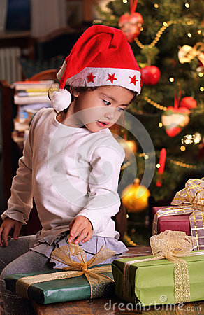 Beautiful little child with xmas gifts