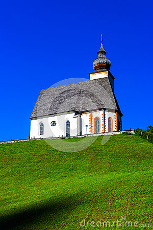 Free Beautiful Little Church In Alps. Sunny Day, Green Grass On The H Stock Photography - 79809652