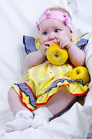 Beautiful little girl and apples