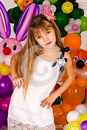 Beautiful little girl in balloon forest
