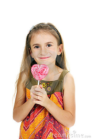Beautiful little girl and candy on stick