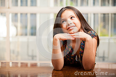 Beautiful little girl daydreaming