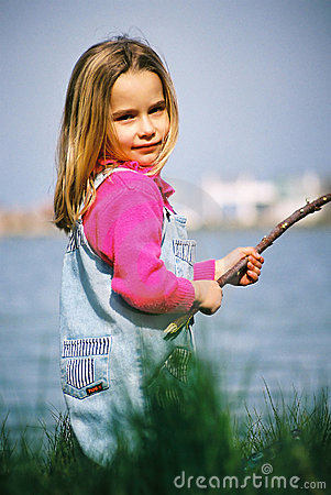 Beautiful little girl fishing