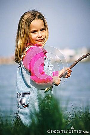 Beautiful little girl fishing