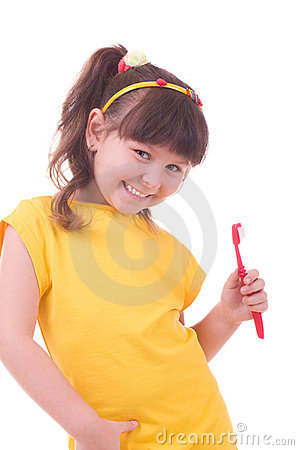 Beautiful little girl flossing her teeth