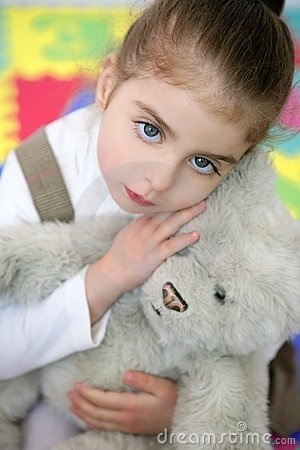 Beautiful little girl hug teddy bear