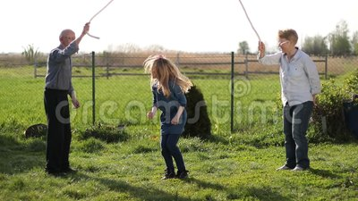 Beautiful little girl jumping over rope outdoors stock footage