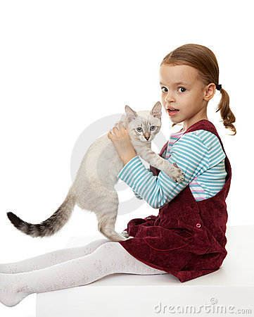 Beautiful little girl with a kitten.