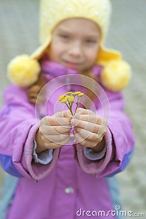 Beautiful little girl in pink coat