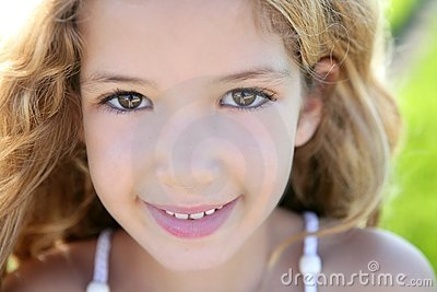 Beautiful little girl portrait smiling closeup face