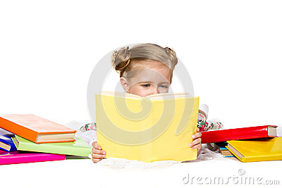 Beautiful  little girl  reading the book