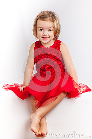 Beautiful little girl in red dresses