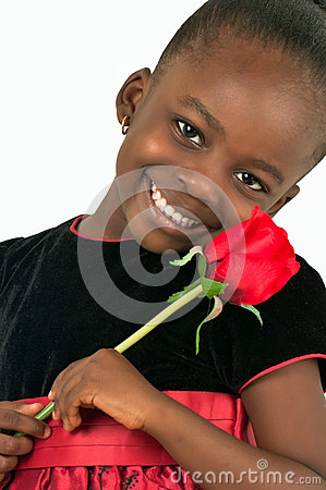 Beautiful little girl with red rose