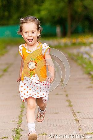 Beautiful little girl runs