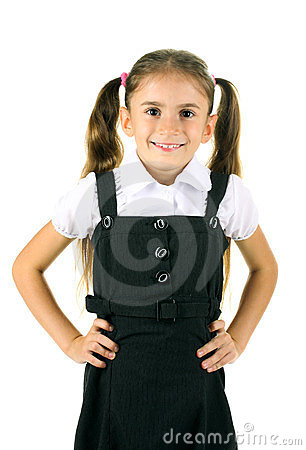Beautiful little girl in school uniform
