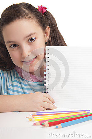 Beautiful little girl showing empty space on notebook