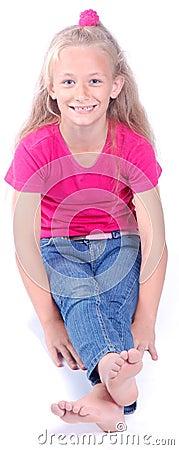 Beautiful little girl sitting Stock Photo