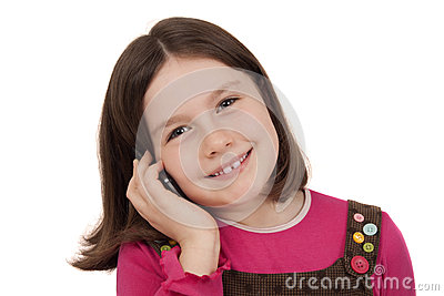 Beautiful little girl talking on a mobile phone