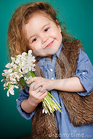 Free Beautiful Little Girl With A Big Bouquet Of Snowdrops. Royalty Free Stock Photography - 51142907