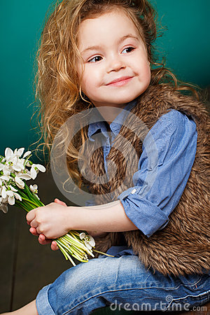 Free Beautiful Little Girl With A Big Bouquet Of Snowdrops. Royalty Free Stock Photos - 51142908