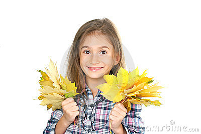 Beautiful little girl and yellow maple leaves
