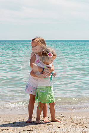 Free Beautiful Little Girls (sisters) Play On The Beach. Stock Photo - 57129040