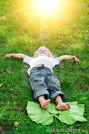 Free Beautiful Little Toddler Girl Happy Lying On Grass Royalty Free Stock Photography - 11309437