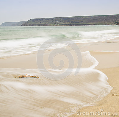 Beautiful long exposure image of golden sand beach