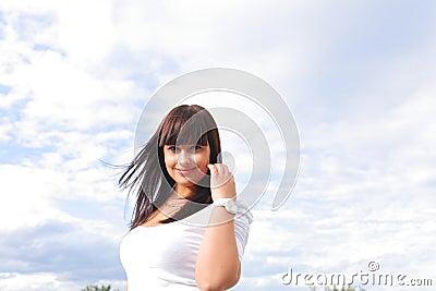 Beautiful long hair brunette sky