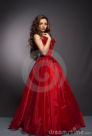 Beautiful long haired woman in red dress