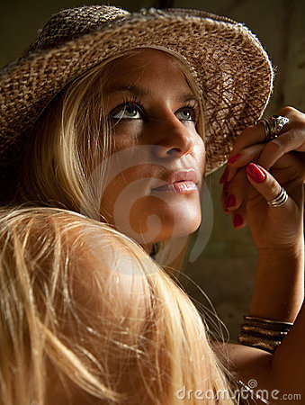 Beautiful  lovely woman with straw hat posing