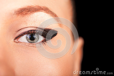 Beautiful macro closeup eye with professional makeup