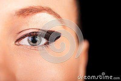 Beautiful macro closeup eye with professional makeup