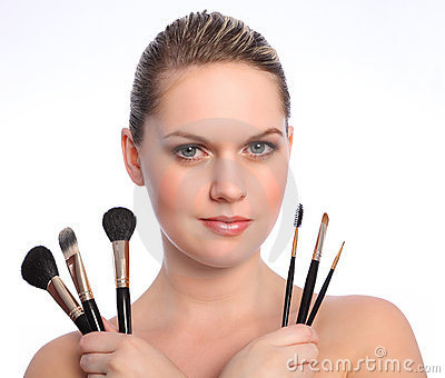 Beautiful make up artist with cosmetic brushes