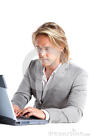 Beautiful man behind a laptop computer