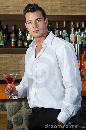 Beautiful man having a martini