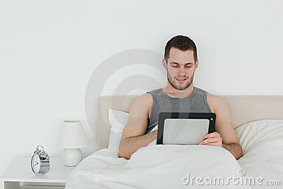 Beautiful man using a tablet computer