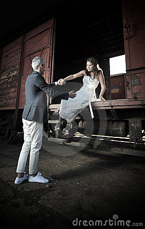 Beautiful married couple in the train