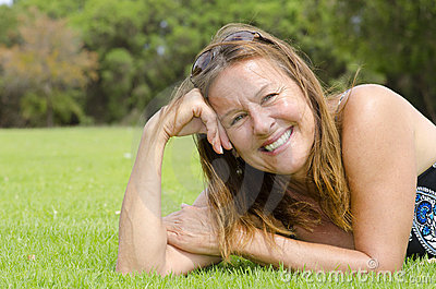 Beautiful mature woman relaxed rest in park