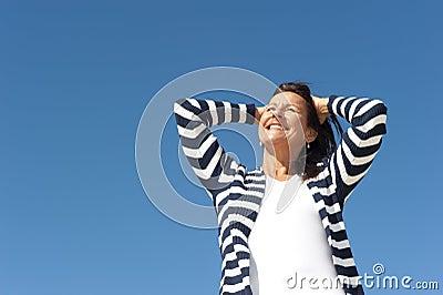 Beautiful mature woman sky background