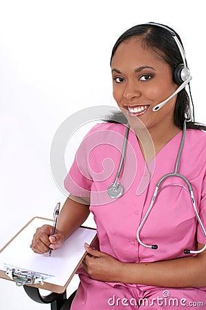 Beautiful Medical Receptionist Wearing Headset